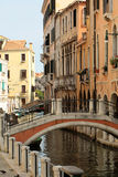 Delightful venetian cityscape. VENICE, ITALY - SEPTEMBER 22: Delightful venetian cityscape of beautiful narrow vintage street with romantic medieval pure Royalty Free Stock Photography