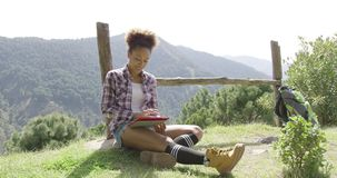 Delightful young backpacker with tablet stock video