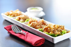 Delights in shrimp. Enjoy the perfect pleasure from a perfect fried shrimp royalty free stock image