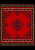 Delikat ethniclmodell av mattan i röda skuggor Royaltyfri Fotografi