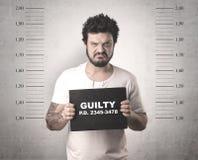 Delincuente cogido en cárcel fotografía de archivo