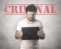 Delincuente cogido en cárcel imagen de archivo libre de regalías