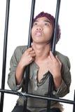 Delincuente juvenil detrás de barras Foto de archivo libre de regalías