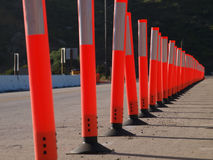 Delineator Detour. A line of delineators cone off a traffic lane for construction Royalty Free Stock Photography