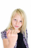 Delinquent adolescents. Young angry girl raises her fist Stock Photography