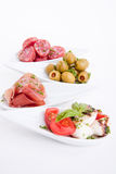 Deliscious开胃小菜板材用帕尔马巴马干酪和橄榄 免版税图库摄影