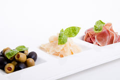 Deliscious antipasti plate with parma parmesan and olives Stock Photo
