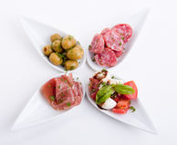 Deliscious antipasti plate with parma parmesan and olives Stock Photography