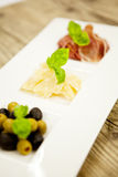 Deliscious antipasti plate with parma parmesan olives Stock Images