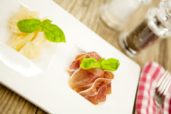 Deliscious antipasti plate with parma parmesan olives Royalty Free Stock Photos