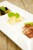 Deliscious antipasti plate with parma parmesan olives Stock Photography