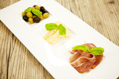 Deliscious antipasti plate with parma parmesan olives Stock Photos
