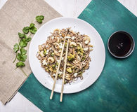 Delisious Japanese buckwheat noodles with squid and oyster mushrooms on a white plate with soy sauce chopsticks wooden rustic Royalty Free Stock Photo