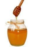 Delisious słodki miodowy spływanie zestrzela w szklanym słoju Obrazy Royalty Free