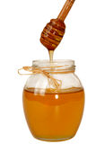 Delisious sweet honey flowing down in glass jar. Royalty Free Stock Images