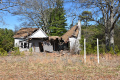 Delisted House Ruin. A grunge abandoned delisted house ruin Stock Photos