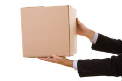 Deliver the parcel. A businessman holding a pile of pakage parcels (isolated on white Royalty Free Stock Photography
