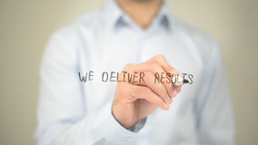We Deliver Results, Man Writing on Transparent Screen. High quality Stock Photography
