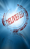 Delivered. Red delivered stamp on a blue background Royalty Free Stock Photography