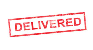Delivered in red rectangular stamp Stock Photography
