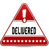 DELIVERED on red triangle road sign. Stock Images