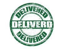 Delivered stamp. Green grunge rubber stamp with the word delivered written inside the stamp Royalty Free Stock Photos