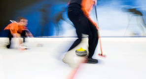 Delivering a curling stone Royalty Free Stock Photo
