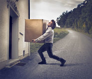 Delivering a Heavy Box Royalty Free Stock Image