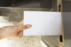Delivering a letter. Into a mailbox white royalty free stock image