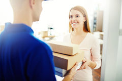 Delivering a parcel Royalty Free Stock Images
