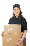 Delivering a parcels fragile. Courier woman delivering a parcels fragile isolated on white background Stock Photography