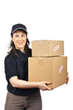 Delivering a parcels fragile. Courier woman delivering a parcels fragile isolated on white background Royalty Free Stock Photo