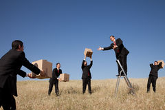 Delivering service. Businessman in the field delivering a package royalty free stock photos