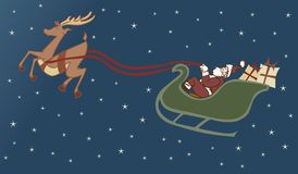 Delivery. Santa delivering presents with his reindeer on Christmastide Stock Image
