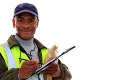 Delivery. Image of a delivery man at work with a pen and folder Stock Photography