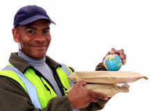 Delivery. Image of a delivery man with wrapped packages and globe Stock Photos