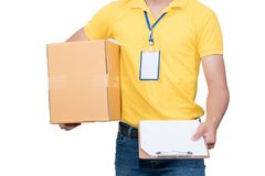 Delivery man holding  cardboard boxes. Delivery asian man. Happy young courier holding  box and smiling on white background Stock Photography