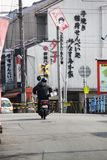 Delivery biker on the streets of Kyoto stock photography