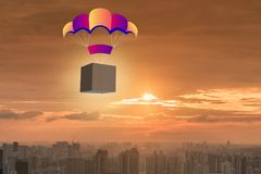 The delivery of boxes concept with parachute Stock Image