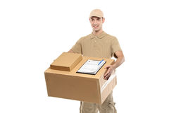 A delivery boy carrying a box Royalty Free Stock Images