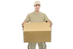 A delivery boy carrying a box Stock Image