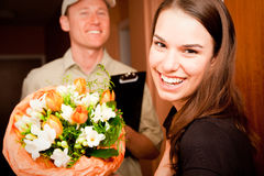 Delivery Boy Handing Over Flowers Royalty Free Stock Photos