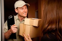Delivery Boy Handing Over Some Packets Royalty Free Stock Image