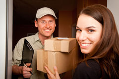 Delivery Boy Handing Over Some Packets Royalty Free Stock Photo