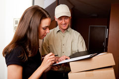 Delivery Boy Handing Over Some Packets Stock Photo