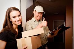 Delivery Boy Handing Over Some Packets Stock Image