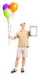 Delivery boy holding balloons and a clipboard Stock Photos