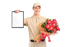 Delivery boy holding a bouquet of flowers Stock Photography