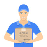 Delivery boy holds a parcel in cardboard box Royalty Free Stock Photography