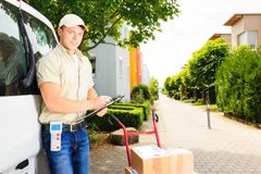 Delivery Boy In Residential Area Stock Image